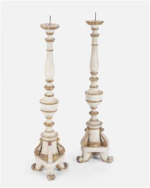A pair of large Continental painted wood pricket