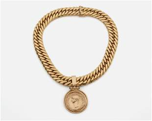 A gold coin style pendant necklace