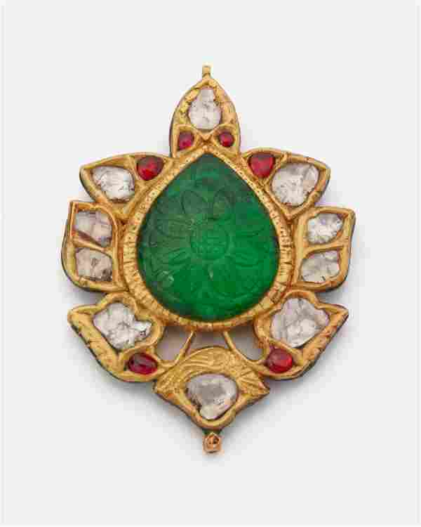An Indian carved gemstone and diamond pendant