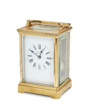 A French brass carriage clock with fitted leather