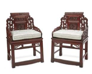 A pair of Chinese carved wood armchairs