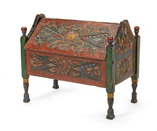 An Indonesian carved wood slant-top trunk