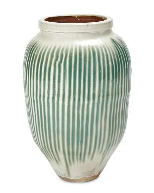 A Japanese Shigaraki stoneware pottery sake jar