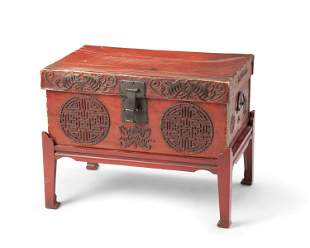A Chinese leather chest on a wood stand