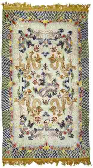 A Chinese silk dragon rug