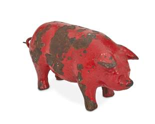 A painted cast iron pig doorstop