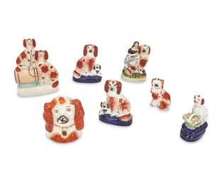 Seven Staffordshire ceramic dog figures