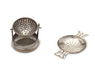 Two Mexican sterling silver tea strainers
