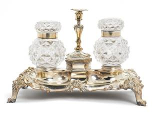 A silver plated and cut crystal footed double inkwell