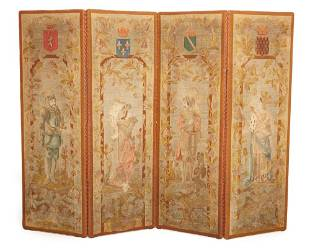 A petit point embroidered four-panel folding screen