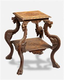 A Continental carved wood side table