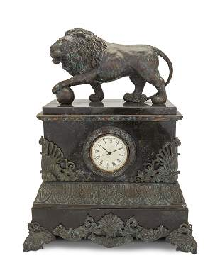 A patinated metal and marble mantel clock