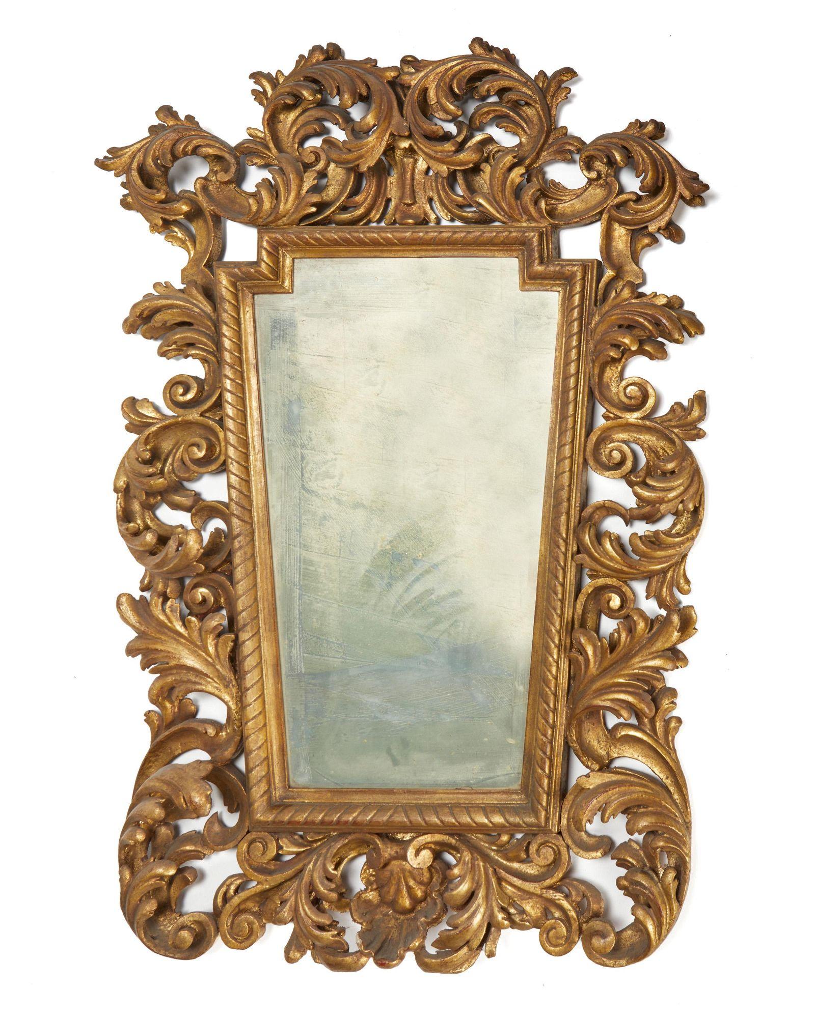 An Italian carved giltwood wall mirror