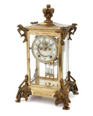 An American Art Nouveau brass crystal regulator mantel
