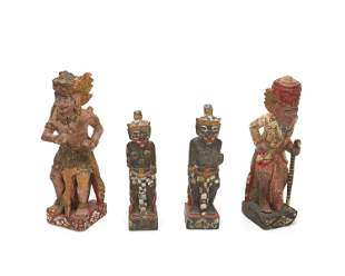 Four Balinese carved wood devotional figures