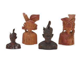 Four Balinese carved wood commemorative busts