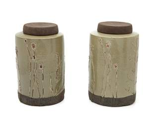 A pair of Asian pottery jars