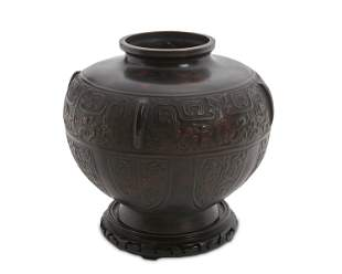 A Chinese bronze jardiniere with stand