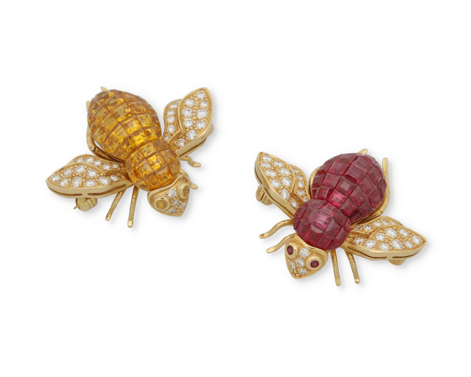 A pair of gemstone and diamond bee brooches