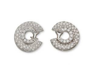 A pair of diamond swirl ear clips