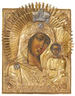 A Russian icon of the Virgin and Child with brass oklad