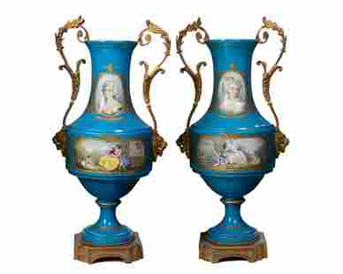 A pair of Sevres-style porcelain urns