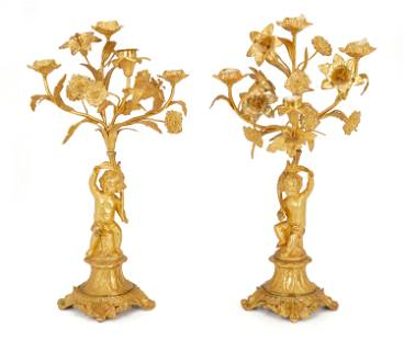 A pair of gilt-bronze candelabra