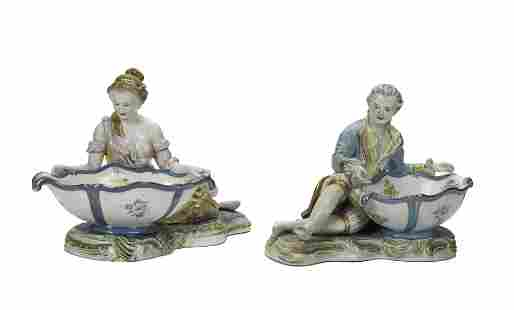 A pair of Meissen-style figural sweet meat porcelain