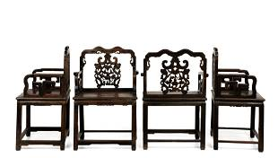 Four Chinese carved wood armchairs