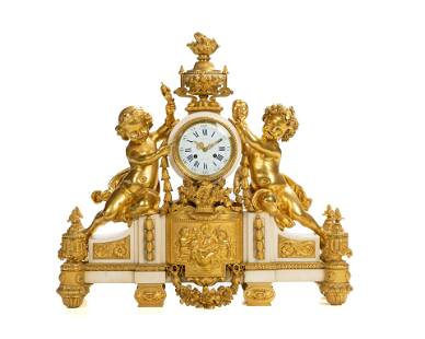 A French gilt-bronze and marble mantel clock retailed