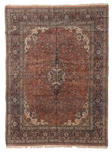 A Kashan area rug