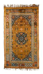 A Chinese silk and metal thread area rug