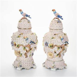 A pair of Dresden relief-decorated porcelain urns