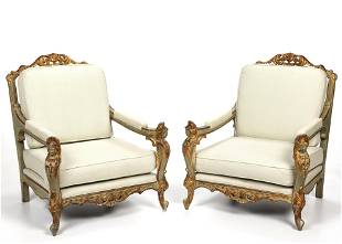 A pair of Italian carved wood armchairs