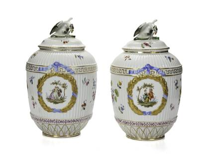 A pair of KPM lidded urns