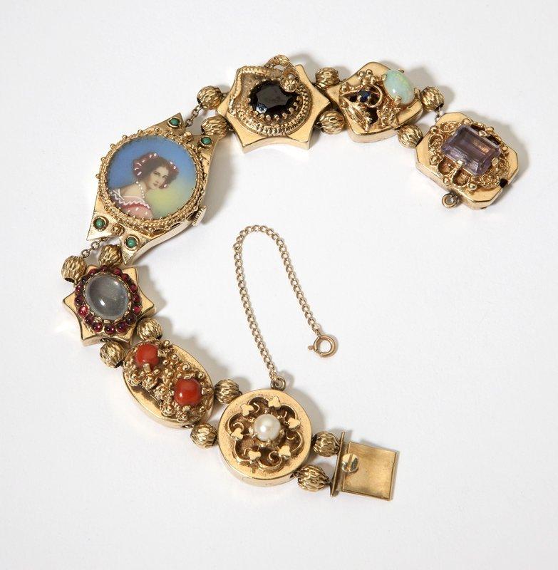 1002: A Victorian gem-set and gold slide watch bracelet