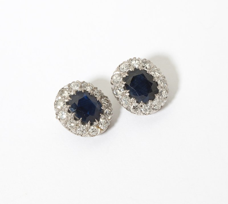 1006: A pair of sapphire, diamond and white gold earrin