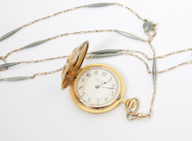1012: A lady's hunter case pocket watch and fob