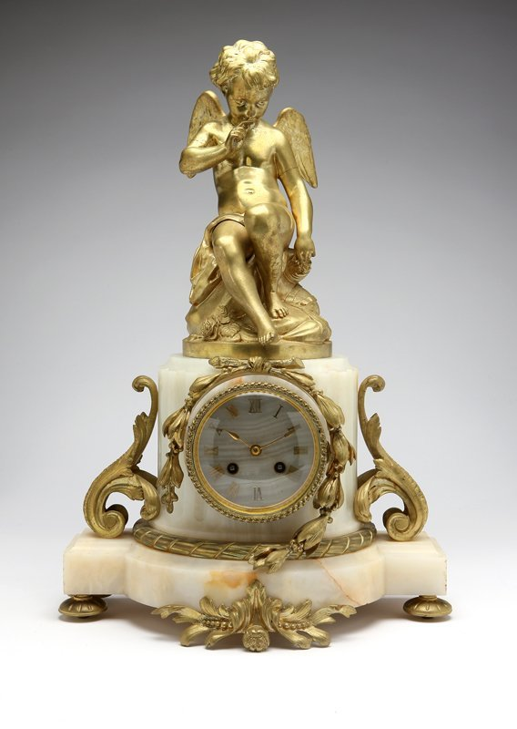 1016: A French gilt bronze and alabaster mantle clock