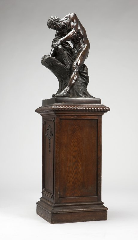 1024: A Continental patinated bronze figure of a woodcu