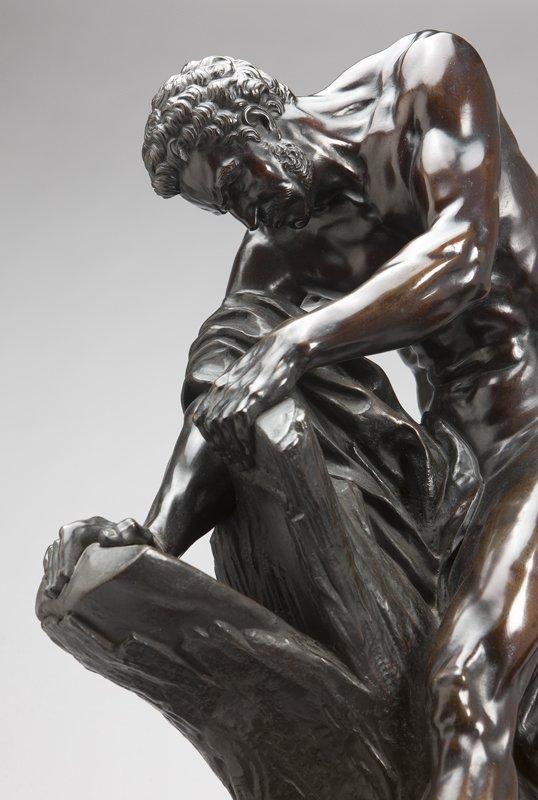 1024: A Continental patinated bronze figure of a woodcu - 2