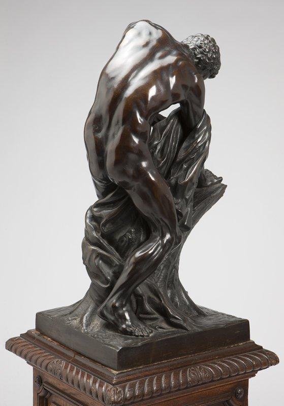 1024: A Continental patinated bronze figure of a woodcu - 3