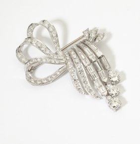 A Diamond And Platinum Ribbon Brooch