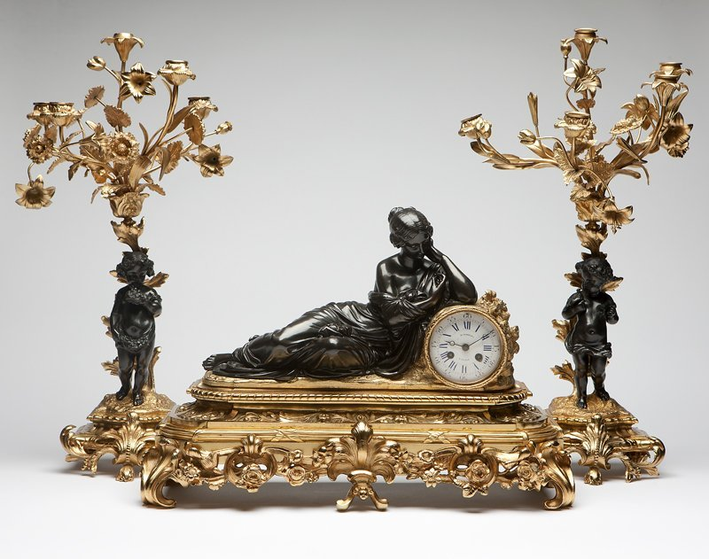 1045: A French patinated and gilt bronze mantel clock a