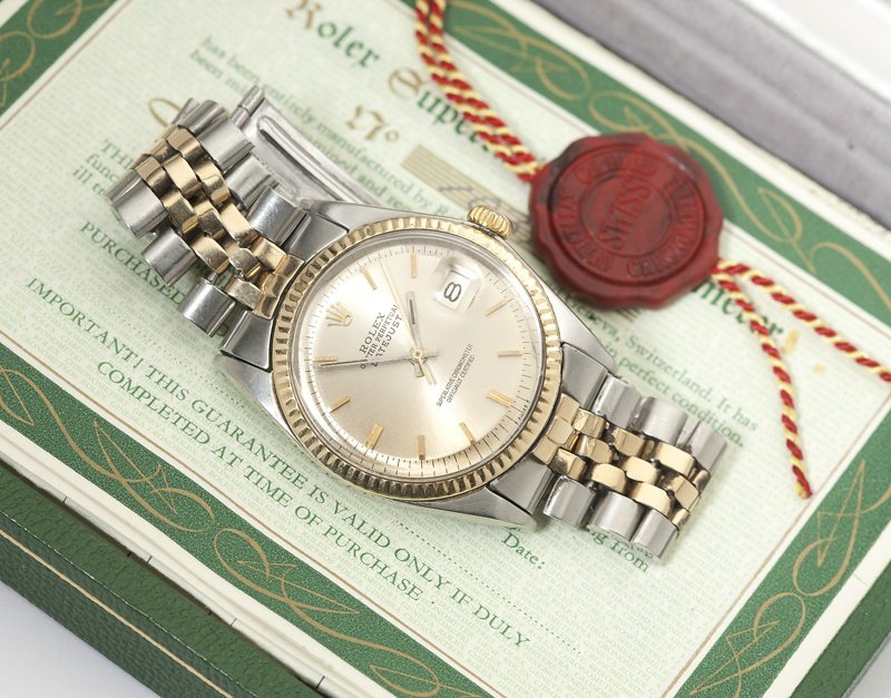 1159: A gentleman's stainless steel and gold wristwatch