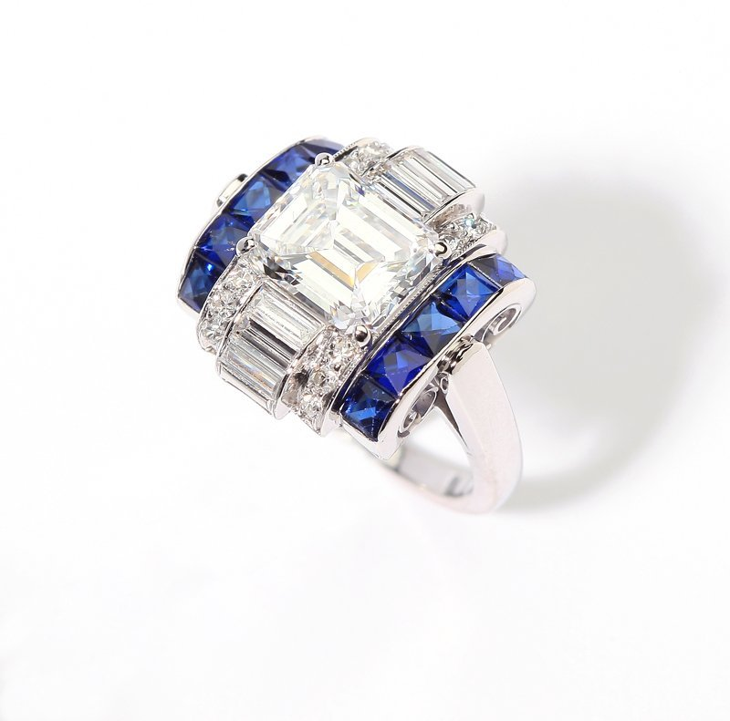 1204: A late Art Deco diamond and sapphire ring