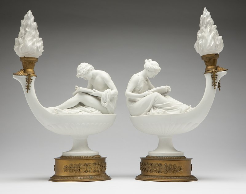 1004: A pair of Continental biscuit porcelain lamps