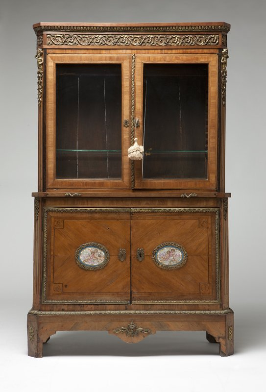 1018: A Louis XVI tulipwood secretary bookcase