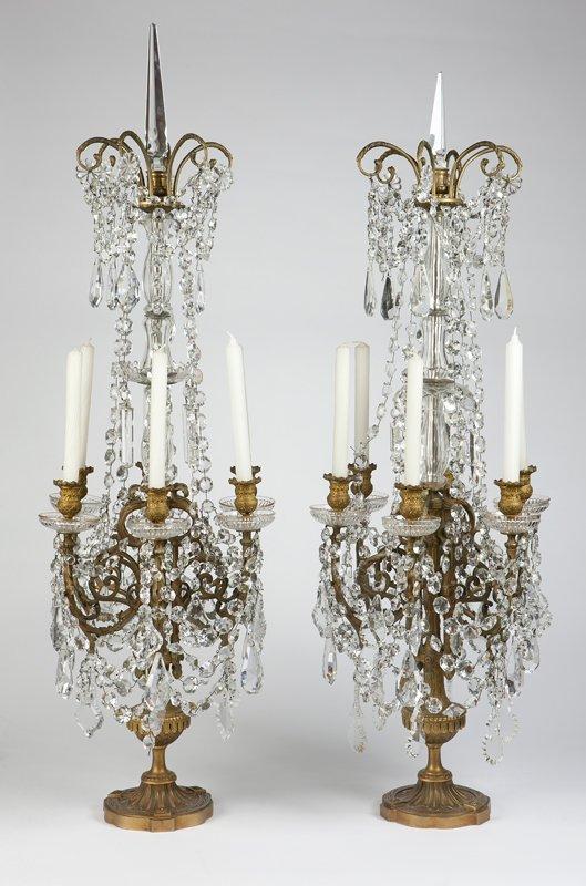 1019: A large pair of gilt bronze & crystal candelabra