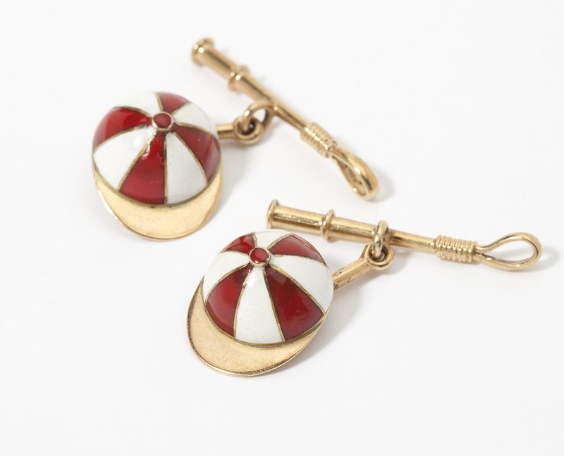 1102: A pair of gold and enamel jockey motif cufflinks